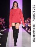 a model walks the runway on the ... | Shutterstock . vector #760575292