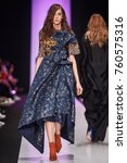 a model walks the runway on the ... | Shutterstock . vector #760575316