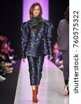 a model walks the runway on the ... | Shutterstock . vector #760575322