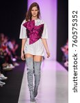 a model walks the runway on the ... | Shutterstock . vector #760575352