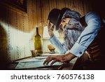 bearded man reads a mysterious... | Shutterstock . vector #760576138