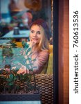 blonde lady blogger in caf ... | Shutterstock . vector #760613536