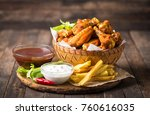 chicken wings with dips on the... | Shutterstock . vector #760616035