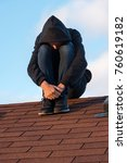 depressed teen boy sitting on... | Shutterstock . vector #760619182