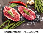 fresh raw beef with rosemary on ... | Shutterstock . vector #760628095
