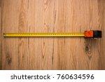 measure tape on wooden... | Shutterstock . vector #760634596