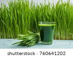 wheat grass juice on table.... | Shutterstock . vector #760641202