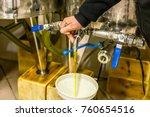 hand opening tap of storage... | Shutterstock . vector #760654516