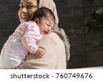 muslim mother caring a little... | Shutterstock . vector #760749676