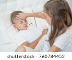girl touches forehead to her... | Shutterstock . vector #760784452