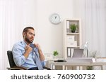 young man feeling hot in office | Shutterstock . vector #760900732