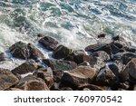 sea waves splash on stones. | Shutterstock . vector #760970542