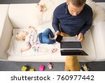 dad working on laptop while his ... | Shutterstock . vector #760977442