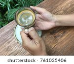 coffee cup on hand | Shutterstock . vector #761025406