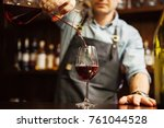 sommelier pouring wine into...   Shutterstock . vector #761044528