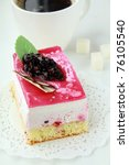 A piece of cake with black currant - stock photo