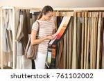 young woman choosing fabric for ... | Shutterstock . vector #761102002