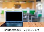 the computer is on the wooden... | Shutterstock . vector #761130175