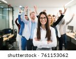 Small photo of Group of successful business people happy in office