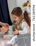 little girl sitting in a bed... | Shutterstock . vector #761184946