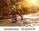 two mountain bikers riding bike ... | Shutterstock . vector #761224378