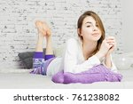 young woman lying in bed ... | Shutterstock . vector #761238082