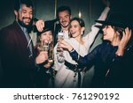 group of happy friends drinking ... | Shutterstock . vector #761290192