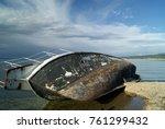 Abandoned Ship Lying On Its...