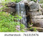 waterfall spring flowers | Shutterstock . vector #761315476