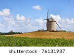 "Traditional windmill in the vicinity of Mont Saint Michel monastery in Base Normandy in France.This is ""Le Moulin Moidrey"". - stock photo"