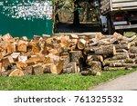 heap of wooden logs in a city... | Shutterstock . vector #761325532
