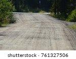 dusty road in nature | Shutterstock . vector #761327506