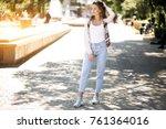 girl posing in the street | Shutterstock . vector #761364016