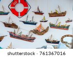 life belt and boats hanging on... | Shutterstock . vector #761367016