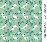 Stock vector vector seamless pattern with funny white rabbits and flowers on a green meadow 761382202