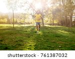 man in yellow shirt running... | Shutterstock . vector #761387032
