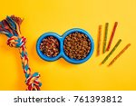 dog food in blue bowl and... | Shutterstock . vector #761393812