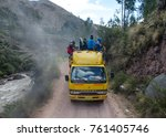Small photo of Ausangate, Peru - 12 February 2016: Mountain bus transport in beru. Dander track with people on the mountains road in Peru