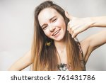 woman shows call with hand on a ... | Shutterstock . vector #761431786