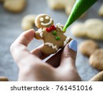 gingerbread man in the making | Shutterstock . vector #761451016