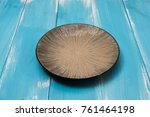 round plate on blue wooden... | Shutterstock . vector #761464198