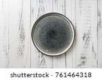 round plate on white wooden... | Shutterstock . vector #761464318