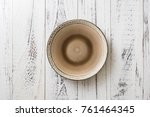 round plate on white wooden... | Shutterstock . vector #761464345
