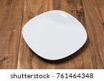 white plate on brown wooden... | Shutterstock . vector #761464348