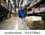 Small photo of Caucasian man is lifting thing from shelf