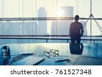 businessman in a big office | Shutterstock . vector #761527348