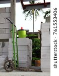 Small photo of the green pushcart has been self modify to extend the folk, unsafe condition