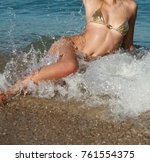 sexy girl in bikini posing on... | Shutterstock . vector #761554375