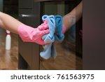employee hand in rubber...   Shutterstock . vector #761563975