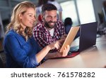 colleagues working together in...   Shutterstock . vector #761578282